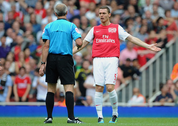 LONDON, ENGLAND - AUGUST 20:  Thomas Vermaelen of Arsenal remonstrates with referee Martin Atkinson during the Barclays Premier League match between Arsenal and Liverpool at the Emirates Stadium on August 20, 2011 in London, England.  (Photo by Michael Re