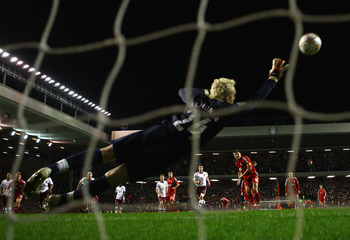 LIVERPOOL, UNITED KINGDOM - APRIL 08:   Manuel Almunia of Arsenal is unable to stop Steven Gerrard of Liverpool scoring his team's third goal from the penalty spot during the UEFA Champions League Quarter Final, second leg match between Liverpool and Arse
