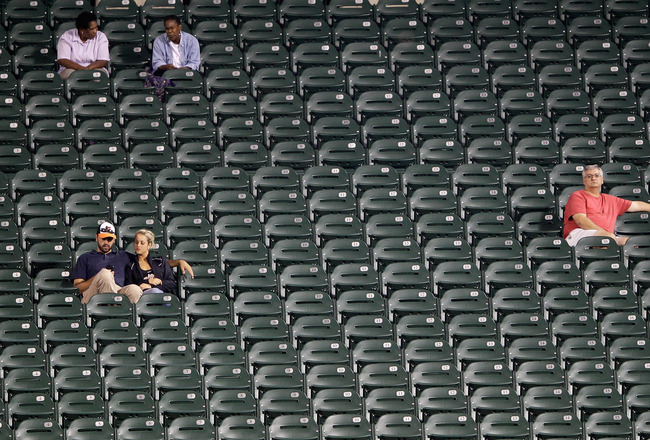 BALTIMORE, MD - SEPTEMBER 12: Fans watch the eighth inning from the seats in the outfield during the Baltimore Orioles and Tampa Bay Rays game at Oriole Park at Camden Yards on September 12, 2011 in Baltimore, Maryland.  (Photo by Rob Carr/Getty Images)