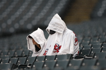 CLEVELAND,OH - AUGUST 14:  A pair of Cleveland Indians fans wait out the rain delay during the game between the Minnesota Twins and Cleveland Indians on August 14, 2011 at Progressive Field in Cleveland, Ohio.  (Photo by John Grieshop/Getty Images)