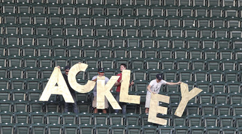 SEATTLE - AUGUST 15:  Fans of Dustin Ackley #13 of the Seattle Mariners hold up a giant sign after Aaron Hill of the Toronto Blue Jays grounded out to Ackley in the second inning at Safeco Field on August 15, 2011 in Seattle, Washington. (Photo by Otto Gr