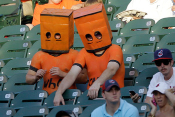 BALTIMORE, MD - JULY 16: Two Baltimore Orioles fans wear masks over their heads during the third inning of the Orioles and Cleveland Indians game at Oriole Park at Camden Yards on July 16, 2011 in Baltimore, Maryland.  (Photo by Rob Carr/Getty Images)