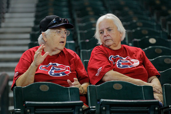 PHOENIX, AZ - SEPTEMBER 11:  Two Arizona Diamondbacks fans wait for the begining of the MLB game against the San Diego Padres at Chase Field on September 11, 2011 in Phoenix, Arizona. The Dbacks gave away tshirts with a patriotic team logo in rememberance