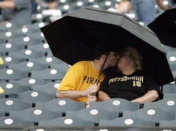 PITTSBURGH, PA - SEPTEMBER 05:  Pirate fans wait out the rain delay before the start of play between the Pittsburgh Pirates and the Houston Astros on September 5, 2011 at PNC Park in Pittsburgh, Pennsylvania.  (Photo by Justin K. Aller/Getty Images)