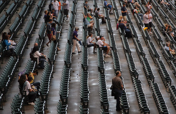 DENVER, CO - AUGUST 16:  Fans head for their seats prior to the game as the Florida Marlins face the Colorado Rockies at Coors Field on August 16, 2011 in Denver, Colorado.  (Photo by Doug Pensinger/Getty Images)