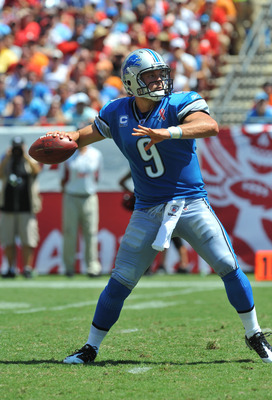 TAMPA, FL - SEPTEMBER 11:  Quarterback Matthew Stafford #9 of the Detroit Lions sets to pass against the Tampa Bay Buccaneers at Raymond James Stadium September 11, 2011 in Tampa, Florida. (Photo by Al Messerschmidt/Getty Images)