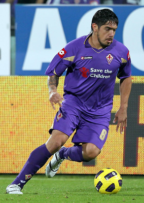 FLORENCE, ITALY - NOVEMBER 14:  Juan Manuel Vargas of ACF Fiorentina in action during the Serie A match between Fiorentina and Cesena at Stadio Artemio Franchi on November 14, 2010 in Florence, Italy.  (Photo by Gabriele Maltinti/Getty Images)