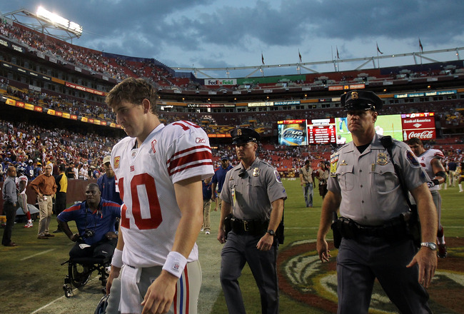 LANDOVER, MD - SEPTEMBER 11:   Eli Manning #10 of the New York Giants walks off the field after losing the season opener against the Washington Redskins at FedExField on September 11, 2011 in Landover, Maryland.  (Photo by Ronald Martinez/Getty Images)