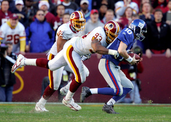 LANDOVER, MD - DECEMBER 24:  Phillip Daniels #93 of the Washington Redskins sacks Eli Manning #10 of the New York Giants on December 24, 2005 at FedEx Field in Landover, Maryland.The Redskins defeated the Giants 35-20.  (Photo by Jim McIsaac/Getty Images)
