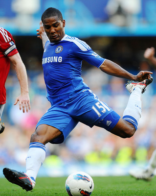 LONDON, ENGLAND - AUGUST 20:  Florent Malouda of Chelsea closed down by Chris Brunt of West Brom as he takes a shot on goal during the Barclays Premier League match between Chelsea and West Bromwich Albion at Stamford Bridge on August 20, 2011 in London,