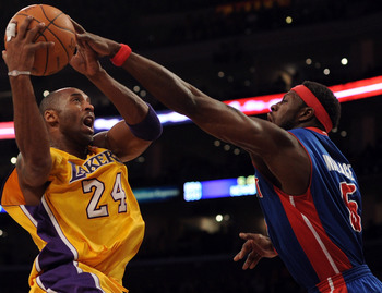LOS ANGELES, CA - JANUARY 04:  Kobe Bryant #24 of the Los Angeles Lakers drives on Ben Wallace #6 of the Detroit Pistons during the first half at the Staples Center on January 4, 2011 in Los Angeles, California. NOTE TO USER: User expressly acknowledges a