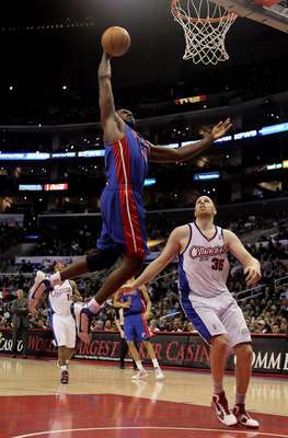 LOS ANGELES, CA - FEBRUARY 24:  Jason Maxiell #54 of the Detroit Pistons drives to the basket over Chris Kaman #35 of the Los Angeles Clippers for a dunk during the first half at Staples Center on February 24, 2010 in Los Angeles, California. NOTE TO USER