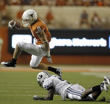 AUSTIN, TX - SEPTEMBER 10:  Wide receiver Jaxon Shipley #8 of the Texas Longhorns hurdles defensive back Joe Sampson #5 of the BYU Cougars in the fourth quarter on September 10, 2011 at Darrell K. Royal-Texas Memorial Stadium in Austin, Texas.  Texas defe
