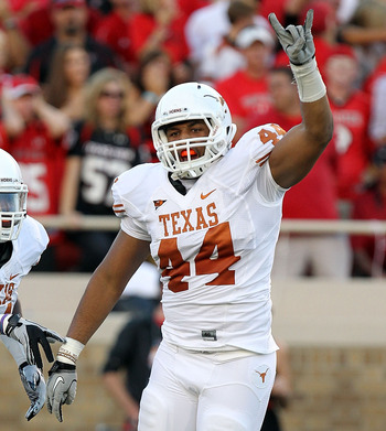 LUBBOCK, TX - SEPTEMBER 18:  Jackson Jeffcoat #44 of the Texas Longhorns celebrates a fumble recovery with Sam Acho #81 in the first quarter against the Texas Tech Red Raiders at Jones AT&amp;T Stadium on September 18, 2010 in Lubbock, Texas.  (Photo by Ronal