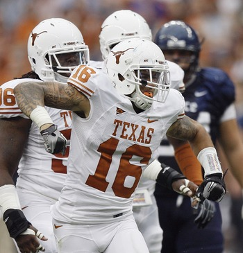 HOUSTON - SEPTEMBER 04:  Safety Kenny Vaccaro #16 of the Texas Longhorns celebrates after a defensive stop against the Rice Owls at Reliant Stadium on September 4, 2010 in Houston, Texas.  (Photo by Bob Levey/Getty Images)