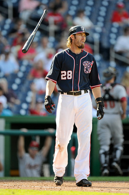 WASHINGTON, DC - SEPTEMBER 11:  Jayson Werth #28 of the Washington Nationals tosses his bat after striking out against the Houston Astros at Nationals Park on September 11, 2011 in Washington, DC.  (Photo by Greg Fiume/Getty Images)