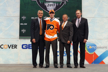 The Flyers brass welcoming the 8th overall pick to the team on draft day.