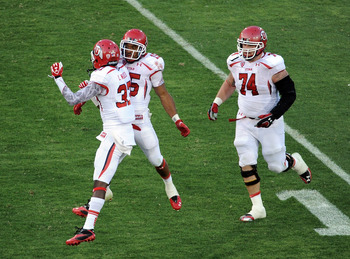 LOS ANGELES, CA - SEPTEMBER 10:  John White #15 of the Utah Utes celebrates his touchdown with Terrell Reese #33 and Sam Brenner #74 to trail 17-14 against the USC Trojans during the third quarter at Los Angeles Memorial Coliseum on September 10, 2011 in