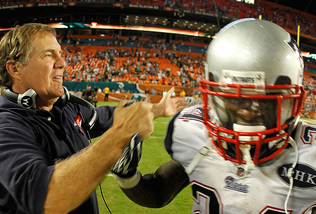 MIAMI GARDENS, FL - SEPTEMBER 12:  New England Patriots head coach Bill Belichick congratulates  Kyle Arrington #24  during a game against the Miami Dolphins at Sun Life Stadium on September 12, 2011 in Miami Gardens, Florida.  (Photo by Mike Ehrmann/Gett