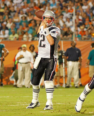 MIAMI GARDENS, FL - SEPTEMBER 12:  Tom Brady #12 of the New England Patriots passes during a game against the Miami Dolphins at Sun Life Stadium on September 12, 2011 in Miami Gardens, Florida.  (Photo by Mike Ehrmann/Getty Images)