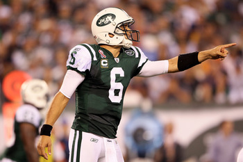 EAST RUTHERFORD, NJ - SEPTEMBER 11:  Mark Sanchez #6 of the New York Jets gestures at the line of scrimmage against the Dallas Cowboys during their NFL Season Opening Game at MetLife Stadium on September 11, 2011 in East Rutherford, New Jersey.  (Photo by