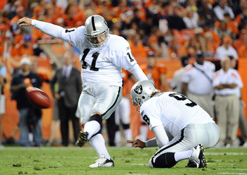 DENVER, CO - SEPTEMBER 12: Sebastian Janikowski #11 of the Oakland Raiders kicks a field goal against the Denver Broncos at Sports Authority Field at Mile High on September 12, 2011 in Denver, Colorado.  (Photo by Garrett W. Ellwood/Getty Images)