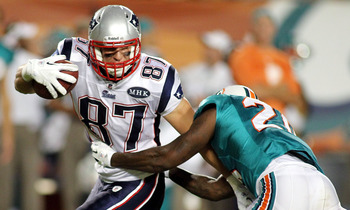 MIAMI GARDENS, FL - SEPTEMBER 12:  Tight end Rob Gronkowski #87 of the New England Patriots makes a catch against Sean Smith #24 of the Miami Dolphins at Sun Life Stadium on September 12, 2011 in Miami Gardens, Florida.  (Photo by Marc Serota/Getty Images