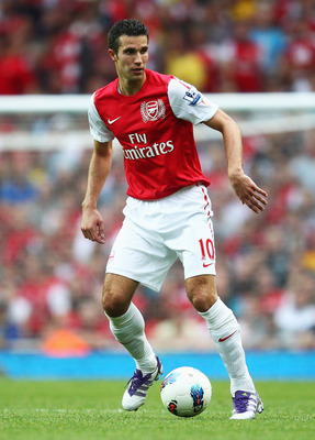 LONDON, ENGLAND - SEPTEMBER 10:  Robin van Persie of Arsenal in action during the Barclays Premier League match between Arsenal and Swansea City at Emirates Stadium on September 10, 2011 in London, England.  (Photo by Clive Mason/Getty Images)