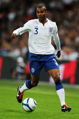LONDON, ENGLAND - SEPTEMBER 06:  Ashley Cole of England runs with the ball during the UEFA EURO 2012 group G qualifying match between England and Wales at Wembley Stadium  on September 6, 2011 in London, England.  (Photo by Ross Kinnaird/Getty Images)