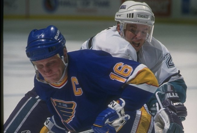 12 Dec 1993:  Rightwinger Brett Hull of the St. Louis Blues and center Terry Yake of the Anaheim Mighty Ducks tangle up during a game at Arrowhead Pond in Anaheim, California.  The Ducks won the game, 2-1. Mandatory Credit: Glenn Cratty  /Allsport