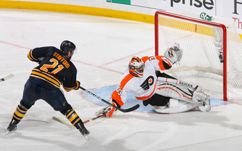 BUFFALO, NY - APRIL 24: Brian Boucher #33 of the Philadelphia Flyers stops Drew Stafford #21 of the Buffalo Sabres in the third period  in Game Six of the Eastern Conference Quarterfinals during the 2011 NHL Stanley Cup Playoffs at HSBC Arena at HSBC Aren