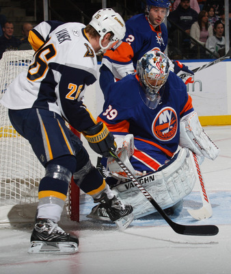 UNIONDALE, NY - JANUARY 16: Rick DiPietro #39 of the New York Islanders stops a shot by Tomas Vanek #26 of the Buffalo Sabres at the Nassau Coliseum on January 16, 2010 in Uniondale, New York.  (Photo by Bruce Bennett/Getty Images)