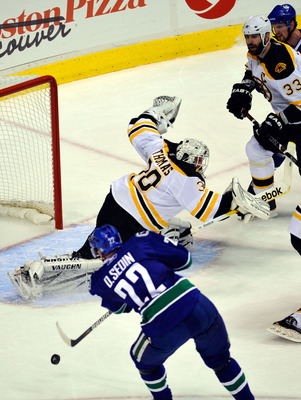 VANCOUVER, BC - JUNE 04:  Daniel Sedin #22 of the Vancouver Canucks scores a goal in the third period against Tim Thomas #30 of the Boston Bruins during Game Two of the 2011 NHL Stanley Cup Final at Rogers Arena on June 4, 2011 in Vancouver, British Colum