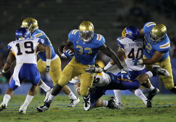 PASADENA, CA - SEPTEMBER 10:  Running back Derrick Coleman #33 of the UCLA Bruins carries the ball against the San Jose State Spartans at the Rose Bowl on September 10, 2011 in Pasadena, California.  UCLA won 27-17.  (Photo by Stephen Dunn/Getty Images)