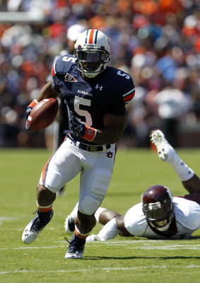 AUBURN, AL - SEPTEMBER 10:  Running back Michael Dyer #5 of the Auburn Tigers breaks for a first down run against the Mississippi State Bulldogs in the second quarter on September 10, 2011 at Jordan-Hare Stadium in Auburn, Alabama. (Photo by Butch Dill/Ge