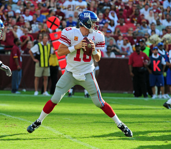 LANDOVER, MD - SEPTEMBER 11: Eli Manning #10 of the New York Giants passes against the Washington Redskins during the season-opening game at FedEx Field on September 11, 2011 in Landover, Maryland. (Photo by Scott Cunningham/Getty Images)