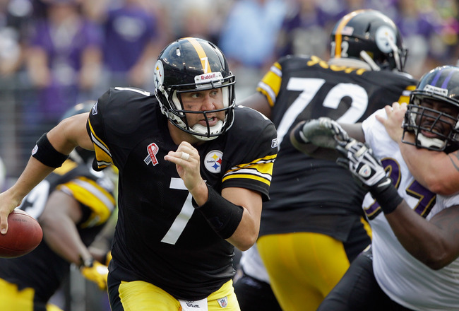 BALTIMORE, MD - SEPTEMBER 11: Quarterback  Ben Roethlisberger #7 of the Pittsburgh Steelers scrambles while being pressured by defender Arthur Jones #97 of the Baltimore Ravens during second half of the season opener at M&T Bank Stadium on September 11, 2