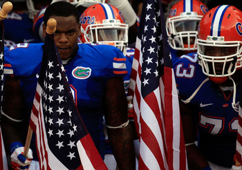 GAINESVILLE, FL - SEPTEMBER 10:  Dominique Easley #2 of the Florida Gators holds an American  flag before a game against the UAB Blazers at Ben Hill Griffin Stadium on September 10, 2011 in Gainesville, Florida.  (Photo by Sam Greenwood/Getty Images)