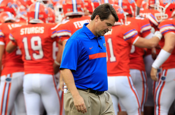 GAINESVILLE, FL - SEPTEMBER 03:  Head coach Will Muschamp of the University of Florida Gators watches the action prior to game against the Florida Atlantic University Owls at Ben Hill Griffin Stadium on September 3, 2011 in Gainesville, Florida.  (Photo b