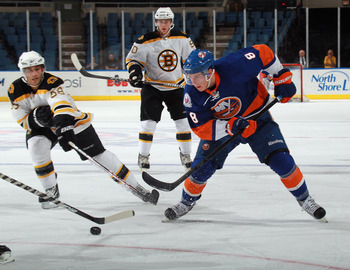 UNIONDALE, NY - SEPTEMBER 12: Ryan Strome #8 of the New York Islanders moves the puck against the Boston Bruins during a rookie game exhibition at Nassau Coliseum on September 12, 2011 in Uniondale, New York.  (Photo by Bruce Bennett/Getty Images)