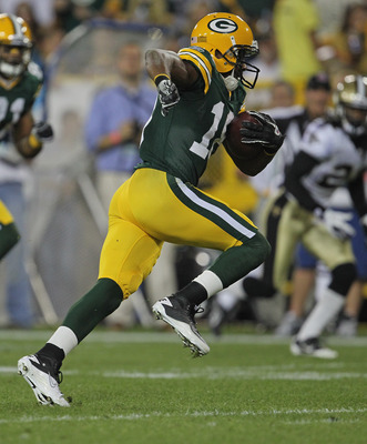 GREEN BAY, WI - SEPTEMBER 08:  Randall Cobb #18 of the Green Bay Packers runs for a touchdown after catching a pass against the New Orleans Saints during the NFL opening season game at Lambeau Field on September 8, 2011 in Green Bay, Wisconsin.  The Packe