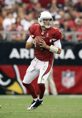 GLENDALE, AZ - SEPTEMBER 11:  Quarterback Kevin Kolb #7 of the Arizona Cardinals scrambles with the football during the NFL season opening game against the Carolina Panthers at the University of Phoenix Stadium on September 11, 2011 in Glendale, Arizona.