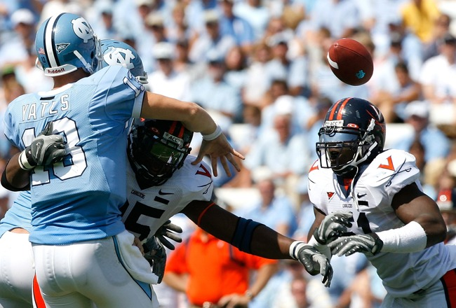 CHAPEL HILL, NC - SEPTEMBER 15:  Quarterback T.J. Yates #13 of the North Carolina Tar Heels releases the ball as he is tackled by defensive end Jeffrey Fitzgerald #95 of the Virginia Cavaliers during the Cavaliers 22-20 win in their Atlantic Coast Confere