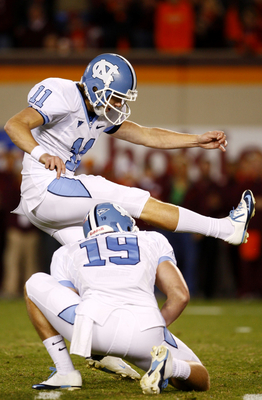 BLACKSBURG, VA - OCTOBER 29:  Kicker Casey Barth #11 of the North Carolina Tar Heels kicks the game-winning field goal over the Virginia Tech University Hokies in the final minutes of the game at Lane Stadium on October 29, 2009 in Blacksburg, Virginia.