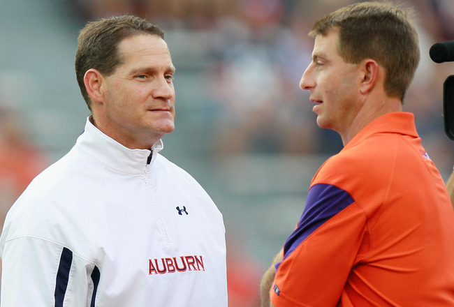 AUBURN, AL - SEPTEMBER 18:  Head coach Dabo Swinney of the Clemson Tigers and head coach Gene Chizik of the Auburn Tigers during pregame at Jordan-Hare Stadium on September 18, 2010 in Auburn, Alabama.  (Photo by Kevin C. Cox/Getty Images)