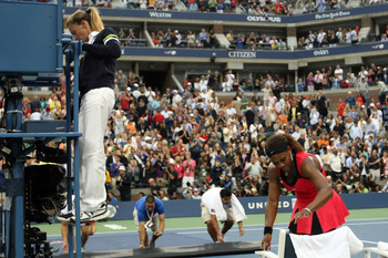 NEW YORK, NY - SEPTEMBER 11:  Serena Williams of the United States sits down as the chair umpire Eva Asderakia climbs down during a break in play against Samantha Stosur of Australia during the Women's Singles Final on Day Fourteen of the 2011 US Open at