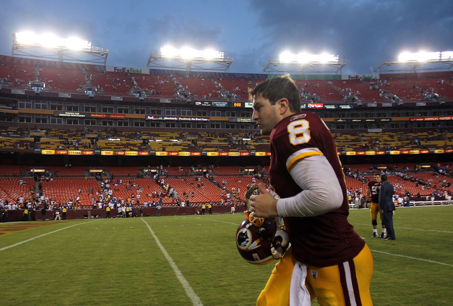 LANDOVER, MD - SEPTEMBER 11:   Rex Grossman #8 of the Washington Redskins runs off the field after winning the season opener against the New York Giants at FedExField on September 11, 2011 in Landover, Maryland.  (Photo by Ronald Martinez/Getty Images)