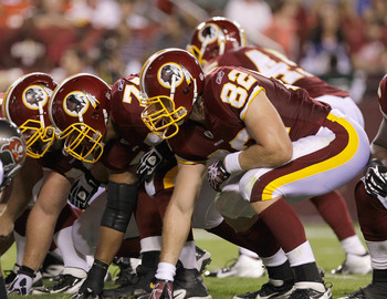 LANDOVER, MD - SEPTEMBER 01: Members of the Washington Redskins offense line up against the defense of the Tampa Bay Buccaneers on an extra point during the first half of a preseason game at FedExField on September 1, 2011 in Landover, Maryland.  (Photo b