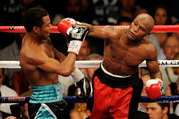 LAS VEGAS - MAY 01:  (R-L) Floyd Mayweather Jr. throws a right to the head of Shane Mosley during the welterweight fight at the MGM Grand Garden Arena on May 1, 2010 in Las Vegas, Nevada.  (Photo by Ethan Miller/Getty Images)
