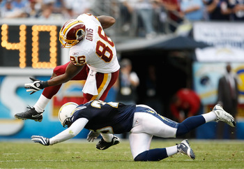 SAN DIEGO - JANUARY 03:  Fred Davis #86 of the Washington Redskins is tackled by Kevin Ellison #25 of the San Diego Chargers in the second half at Qualcomm Stadium on January 3, 2010 in San Diego, California. The Chargers defeated the Redskins 23-20.  (Ph